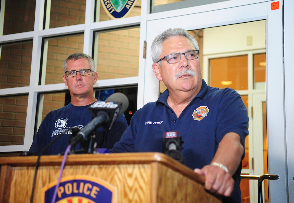 Photo - Prescott, Ariz. Fire Chief Dan Fraijo gives a news conference in Prescott, Ariz., confirming that 19 members of the City of Prescott's Granite Mountain Hotshot team died while fighting the Yarnell Hill Fire, Sunday, June 30, 2013. (AP Photo/The Daily Courier, Les Stukenberg)