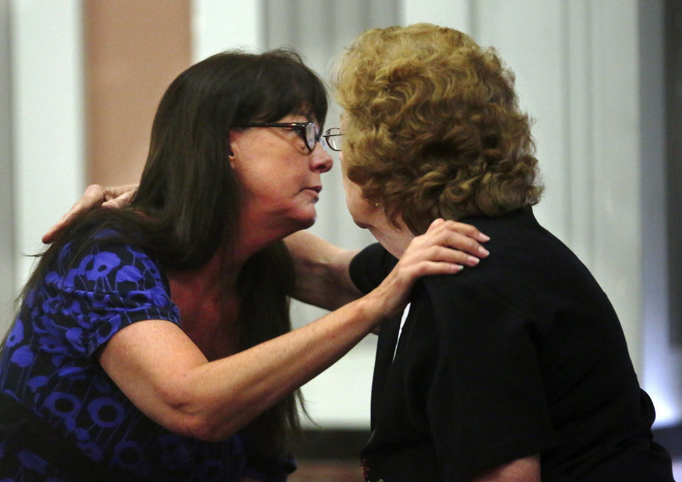 Photo - Lisa Kays, a former Putnam City High School Spanish teacher, hugs a spectator who came to her sentencing on charges of having sex with a male student who was 17 at the time. She received a 4-year sentence. PHOTO BY JIM BECKEL, THE OKLAHOMAN  Jim Beckel