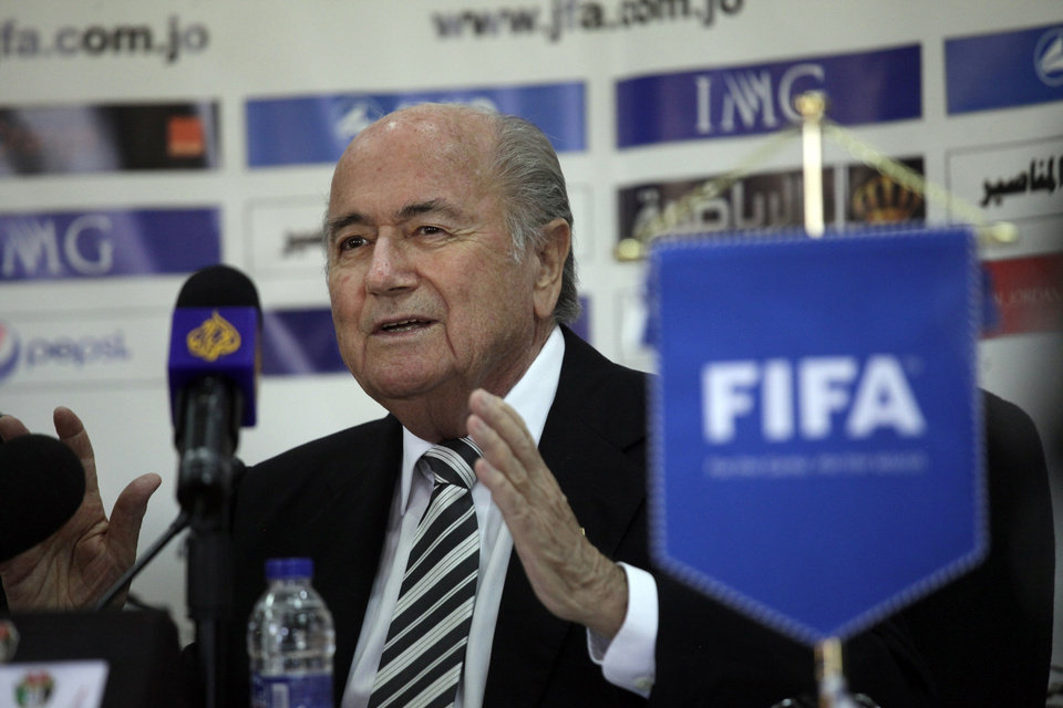 Photo - Sepp Blatter, President of FIFA, speaks during a press conference with FIFA Vice President Jordan's Prince Ali Bin al-Hussein on the first day of Blatter's regional tour to Jordan, Palestinian territories and Israel, in Amman, Jordan, Monday, May 26, 2014. During a joint press conference with Prince Ali at Jordan's Football Association office, Blatter said that his visit to Ramallah and Israel is to defend  football in Palestine and also to defend  football in Israel. (AP Photo/Mohammad Hannon)