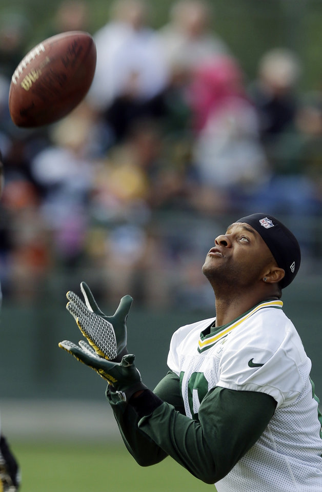 Photo - Green Bay Packers' Randall Cobb catches a ball during NFL football training camp Saturday, July 27, 2013, in Green Bay, Wis. (AP Photo/Morry Gash)