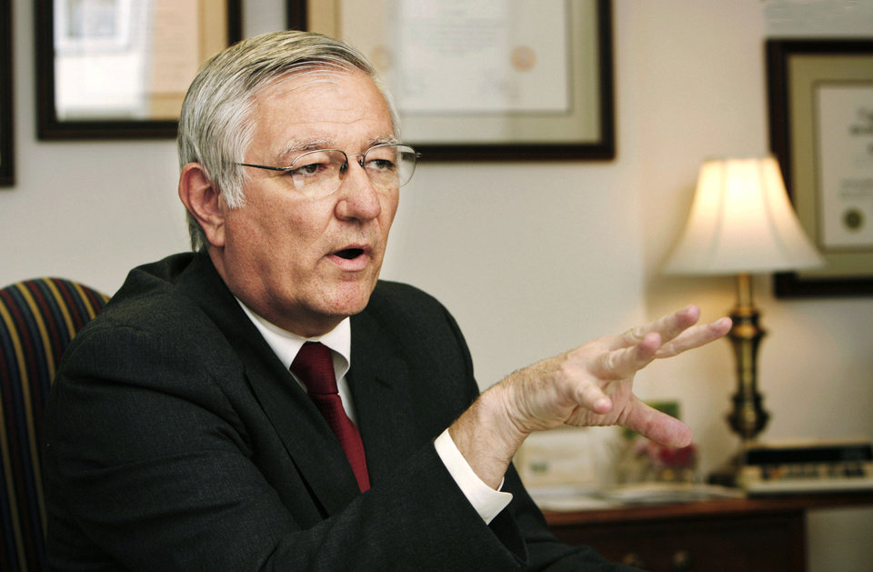 Photo - DHS: Howard Hendrick, director of Oklahoma Department of Human Services, during an interview in his office in the Sequoyah Building near the state Capitol in Oklahoma City, Wednesday, Sep. 26, 2007.  By Jim Beckel,  The Oklahoman.  ORG XMIT: KOD