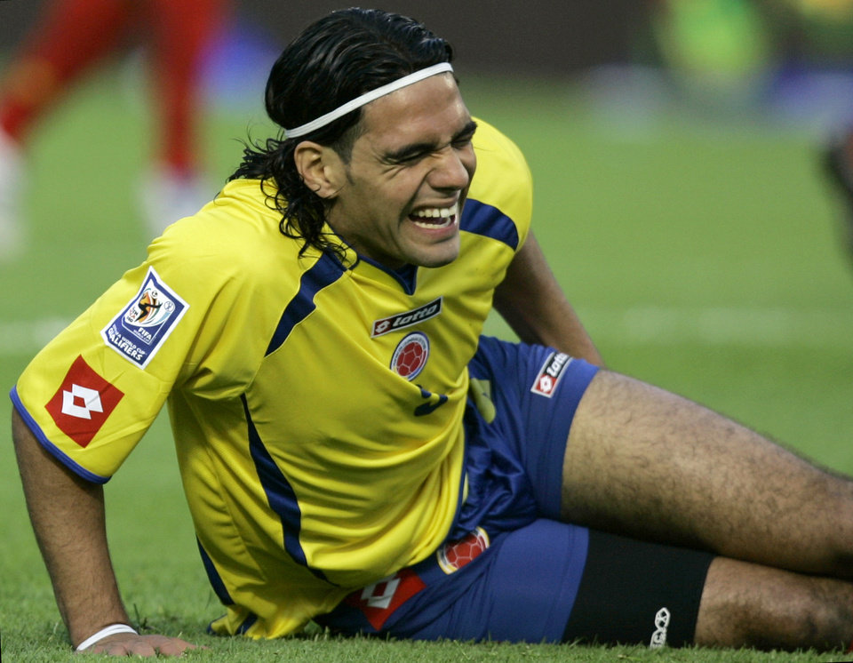 Photo - FILE - I this Nov. 17, 2007 file photo, Colombia's Radamel Falcao gestures on the ground after he was injured during a World Cup 2010 qualifying against Venezuela in Bogota, Saturday, Nov. 17, 2007. Falcao was injured this Wednesday, Jan. 22, 2014 during a French Cup game against Chasselay. (AP Photo/Ricardo Mazalan, File)