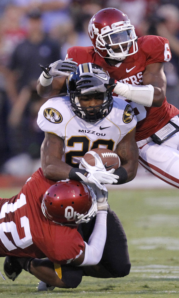 Oklahoma\'s Demontre Hurst (6) and Javon Harris (12) bring down Missouri\'s T.J. More on Saturday. Photo by Chris Landsberger, The Oklahoman