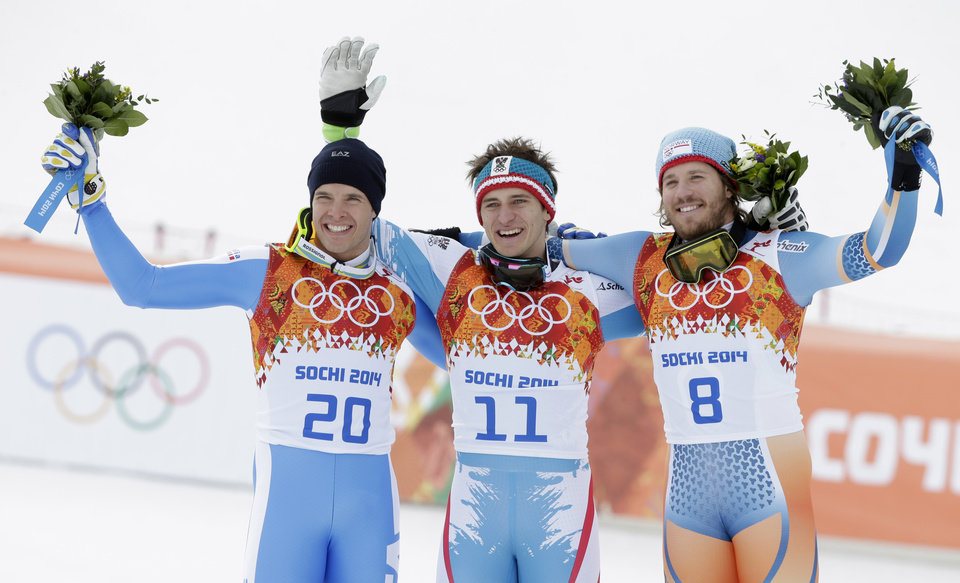 Photo - Men's downhill medalists from left, Italy's Christof Innerhofer, silver, Austria's Matthias Mayer, gold, and Norway's Kjetil Jansrud, bronze, stand on the podium at a flower ceremony at the Sochi 2014 Winter Olympics, Sunday, Feb. 9, 2014, in Krasnaya Polyana, Russia.(AP Photo/Gero Breloer)