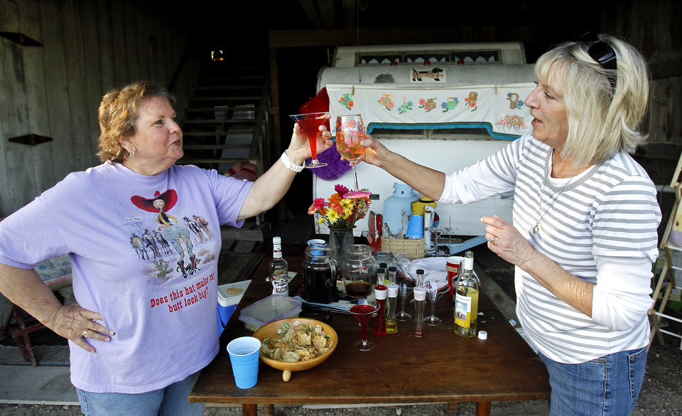 Photo - Helen Elston of Clever, Mo., and Lori Thompson of Leawood, Kan., toast during happy hour in Louisburg, Kansas on April 21, 2012.  The sisters attended the Sisters on the Fly gathering, a national group of camping enthusiasts founded by two actual sisters who love fly-fishing in Montana. (Jill Toyoshiba/Kansas City Star/MCT)