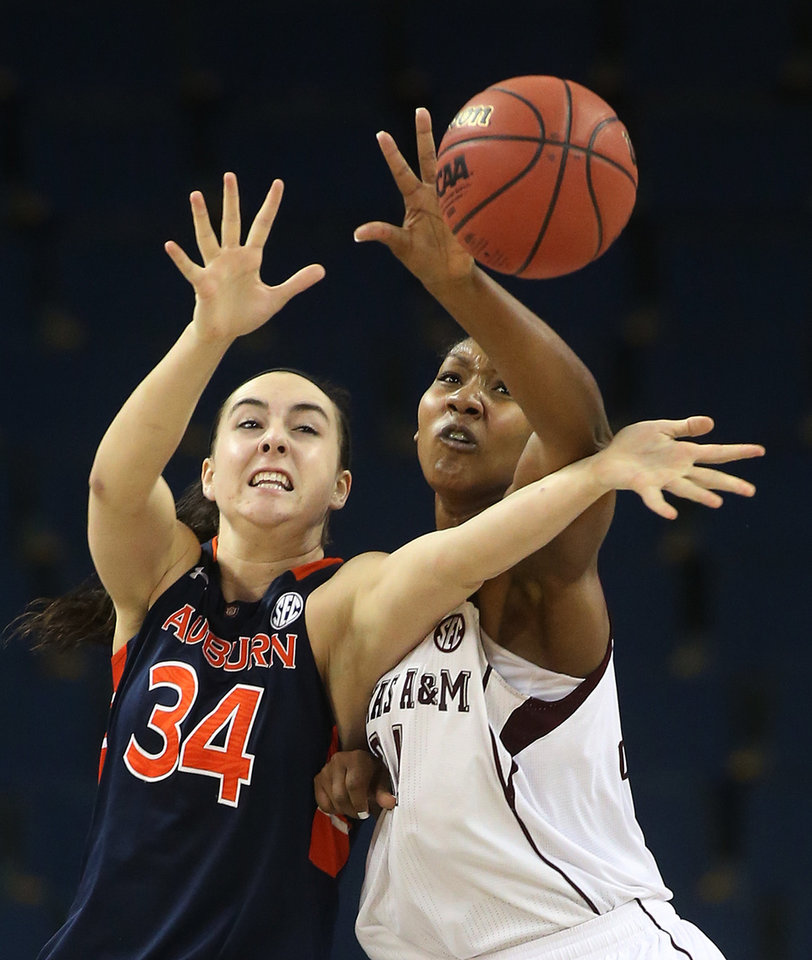 Photo - Auburn center Peyton Davis (34) and Texas A&M center Karla Gilbert reach for a rebound in the second half in an NCAA college basketball game in the quarterfinals of the Southeastern Conference women's tournament, Friday, March 7, 2014, in Duluth, Ga. (AP Photo/Jason Getz)