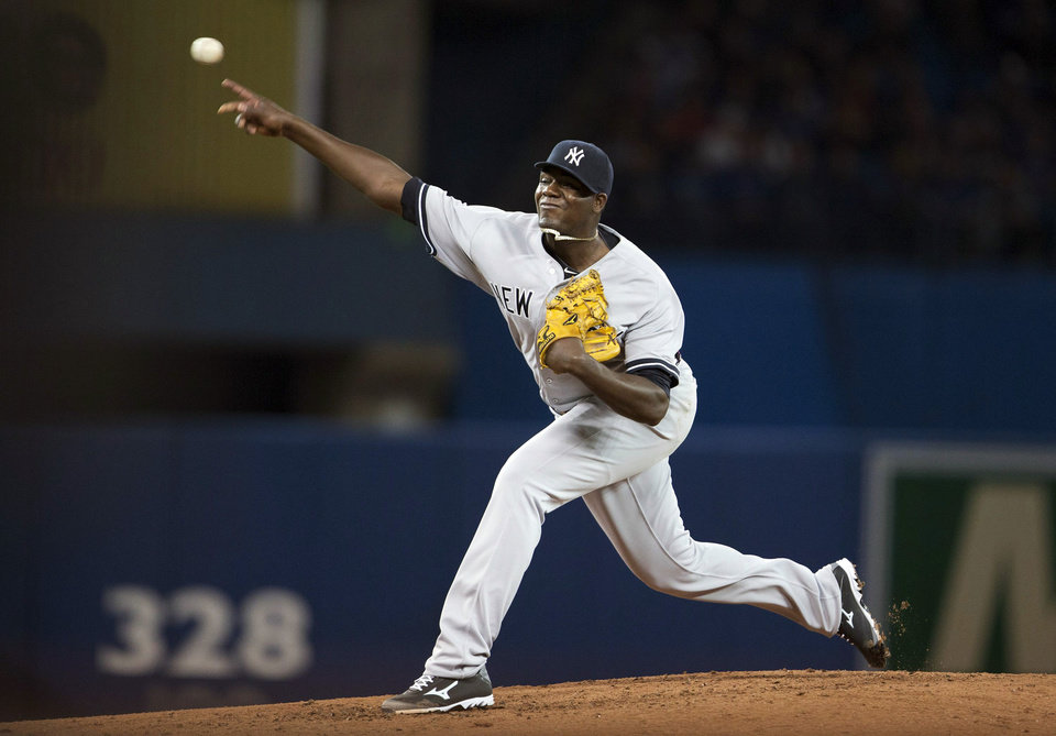 Photo - New York Yankees starting pitcher Michael Pineda delivers a pitch during the third inning of a baseball game in Toronto on Saturday, April 5, 2014. (AP Photo/The Canadian Press, Peter Power)