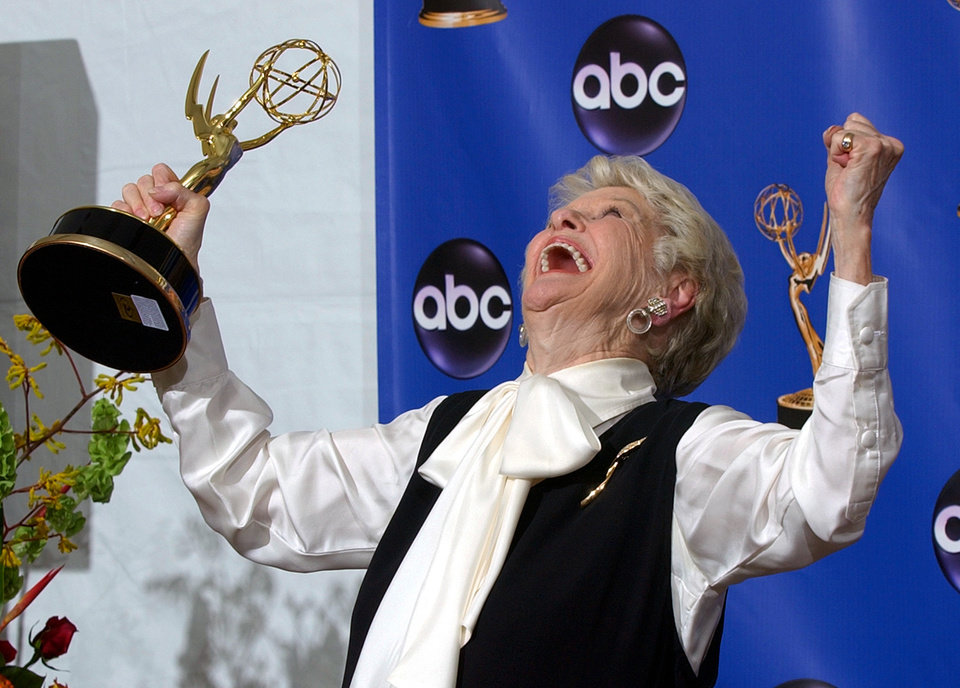 Photo - FILE - This Sept. 19, 2004 file photo shows actress Elaine Stritch celebrating with her trophy for outstanding individual performance in a variety or music program at the 56th Annual Primetime Emmy Awards in Los Angeles. Stritch died Thursday, July 17, 2014 at her home in Birmingham, Mich. She was 89. (AP Photo/Reed Saxon, File)