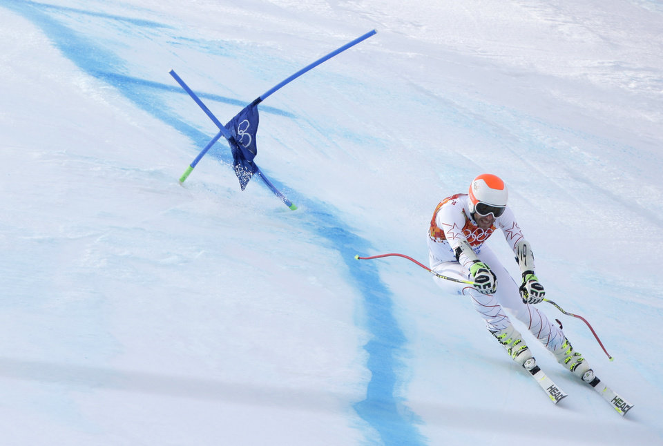 Photo - Joint bronze medal winner Bode Miller of the United States passes a gate in the men's super-G the Sochi 2014 Winter Olympics, Sunday, Feb. 16, 2014, in Krasnaya Polyana, Russia. (AP Photo/Charlie Riedel)