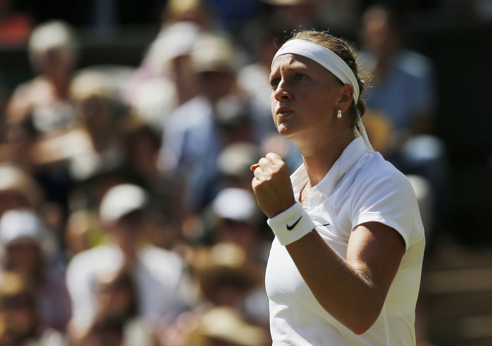 Photo - Petra Kvitova of Czech Republic celebrates winning a point against Lucie Safarova of Czech Republic during their women's singles semifinal match at the All England Lawn Tennis Championships in Wimbledon, London, Thursday, July 3, 2014. (AP Photo/Ben Curtis)
