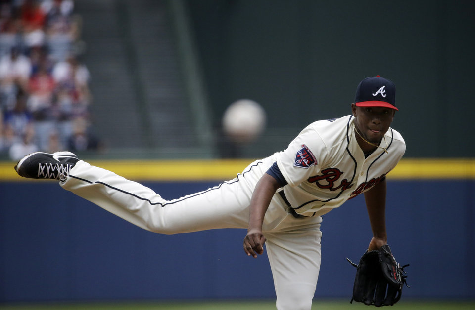 Photo - Atlanta Braves starting pitcher Julio Teheran throws in the first inning of a baseball game against the Cincinnati Reds, Sunday, April 27, 2014, in Atlanta. (AP Photo/David Goldman)