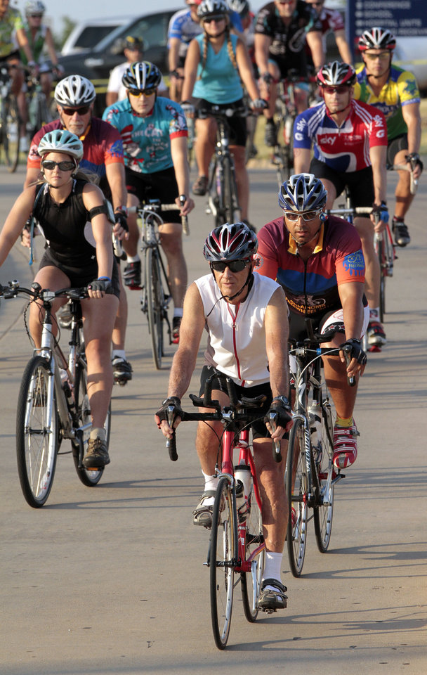 Photo - Riders begin the Norman Conquest Bicycle ride on Saturday in Norman.