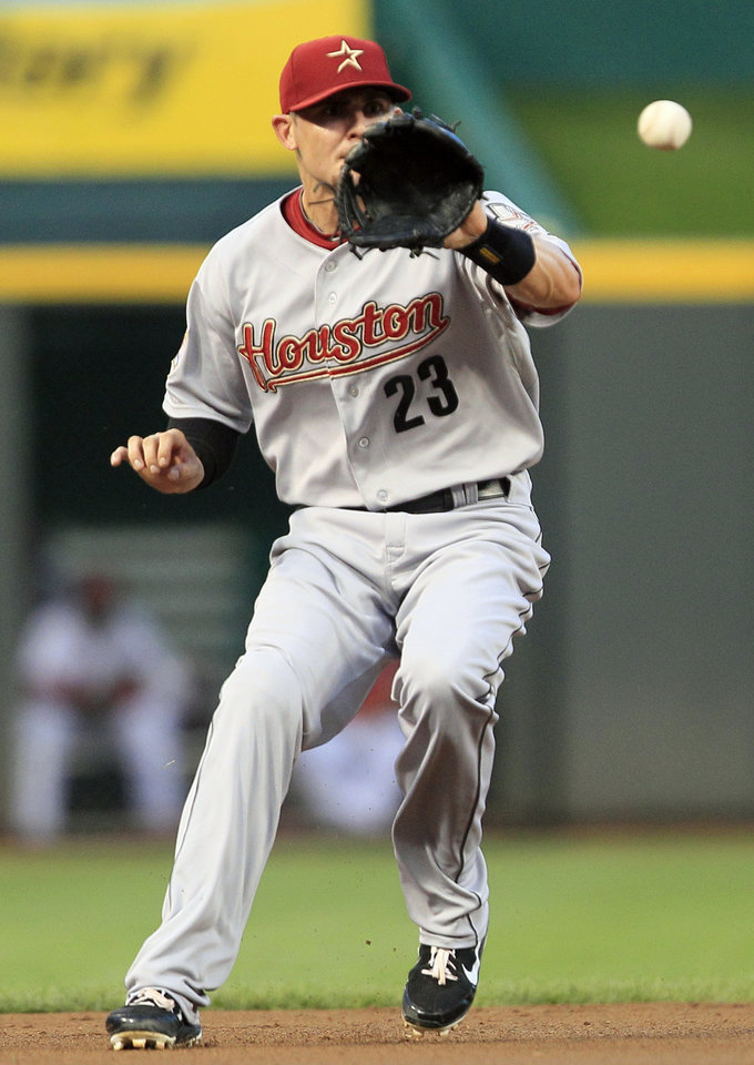 Photo -   Houston Astros shortstop Tyler Greene fields a ground ball hit by Cincinnati Reds' Wilson Valdez in the second inning of a baseball game, Friday, Sept. 7, 2012, in Cincinnati. Greene threw Valez out at first. (AP Photo/Al Behrman)