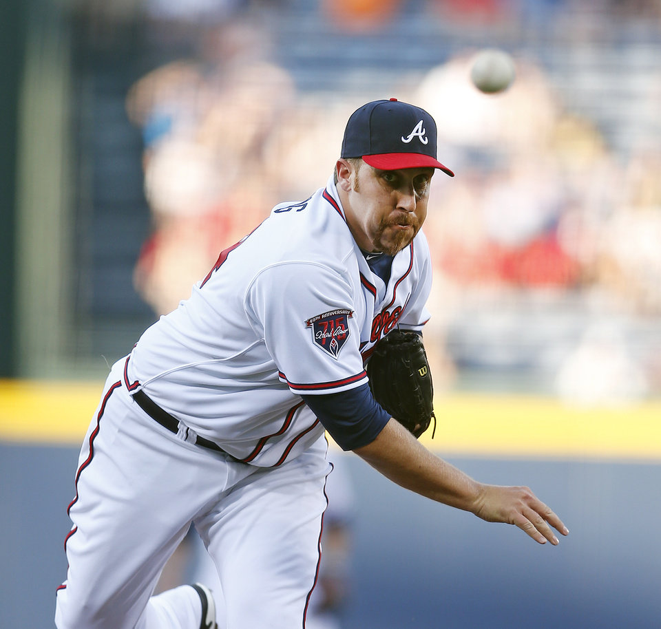 Photo - Atlanta Braves starting pitcher Aaron Harang (34) works against the St. Louis Cardinals in the first inning of a baseball game Monday, May 5, 2014 in Atlanta.  (AP Photo/John Bazemore)