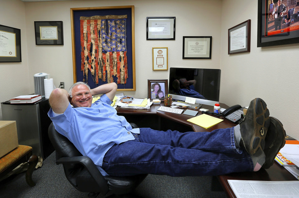 Photo - Dr. Leland Dennis, a psychiatrist in Elk City, is retiring this month.   He is shown relaxing in his office on Tuesday, April 29, 2014.   Photo by Jim Beckel, The Oklahoman