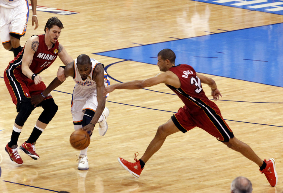 Oklahoma City\'s Kevin Durant (35) fights Miami\'s Mike Miller (13) and Shane Battier (31) for the ball during Game 1 of the NBA Finals between the Oklahoma City Thunder and the Miami Heat at Chesapeake Energy Arena in Oklahoma City, Tuesday, June 12, 2012. Photo by Sarah Phipps, The Oklahoman