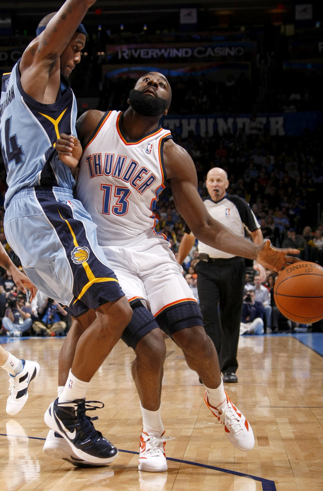 James Harden (13) runs into Memphis\' Dante Cunningham (44) during the NBA game between the Oklahoma City Thunder and the Memphis Grizzlies at Chesapeake Energy Arena in Oklahoma CIty, Friday, Feb. 3, 2012. Photo by Bryan Terry, The Oklahoman