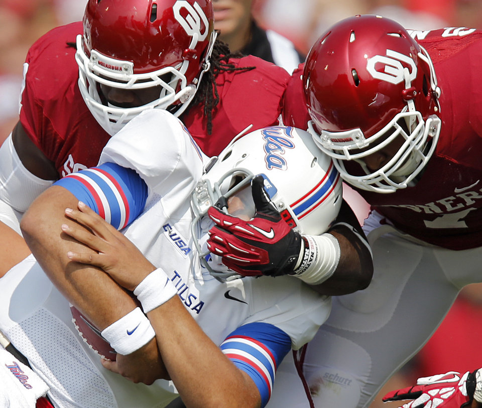 Photo - Oklahoma's Charles Tapper (91) and Corey Nelson (7) bring down Tulsa 's Cody Green (7) during the college football game between the University of Oklahoma Sooners (OU) and the University of Tulsa Hurricanes (TU) at the Gaylord-Family Oklahoma Memorial Stadium on Saturday, Sept. 14, 2013 in Norman, Okla.  Photo by Chris Landsberger, The Oklahoman