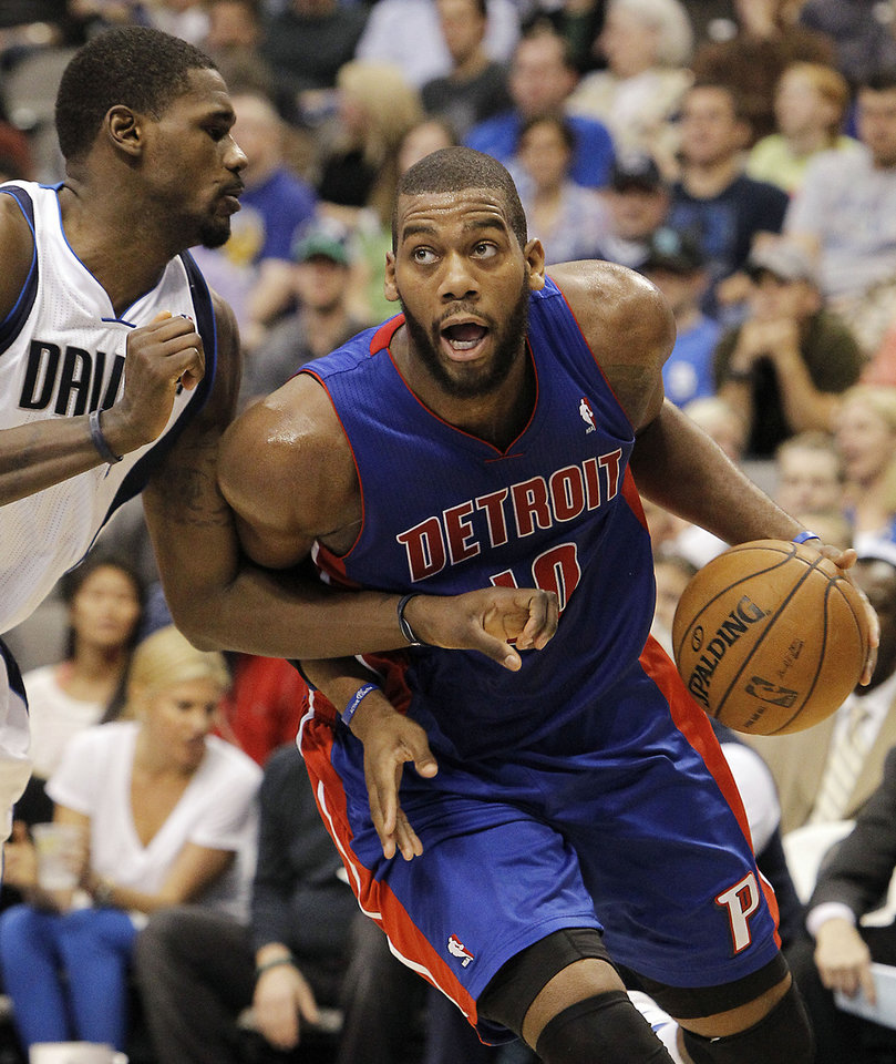 Detroit Pistons center Greg Monroe (10) battles Dallas Mavericks center Bernard James (5) for space during the first half of an NBA basketball game in Dallas, Saturday, Dec. 1, 2012. (AP Photo/Brandon Wade)