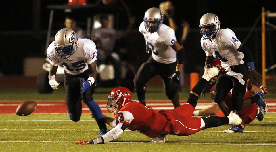 Photo - GHS #15 L'liott Curry goes for a fumble by CA #3 Stevie Thompson as Thomson tries to stop him, but GHS recovered, during the high school football game between Guthrie at Carl Albert in Midwest City, Friday, October 11, 2013.  Photo by Doug Hoke, The Oklahoman