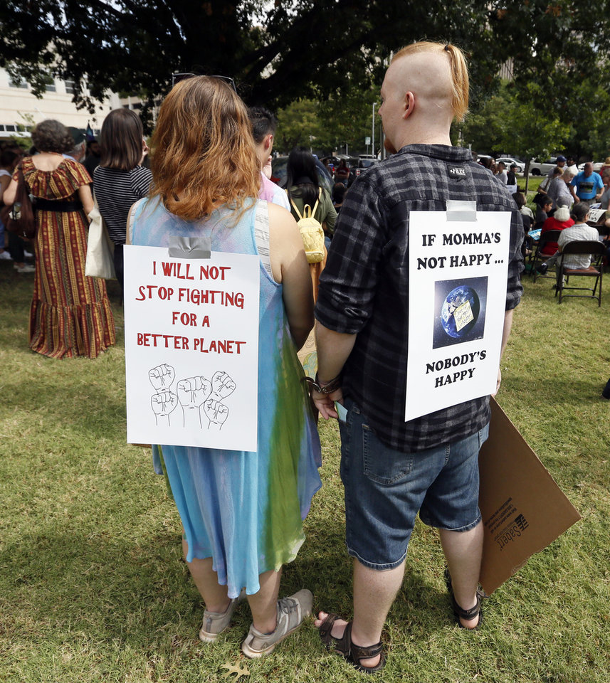 Photo - Kalayla Holmes, left, Matthew Safran wait for speakers to begin during the Oklahoma City Climate Strike event, part of global rallies and marches to bring attention to climate change, outside of City Hall in Oklahoma City, Friday, Sept. 20, 2019. [Nate Billings/The Oklahoman]