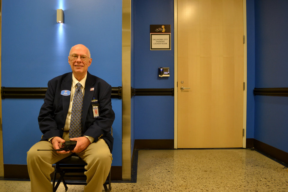 Photo - Dean Taylor watches outside the Thunder locker room at the Chesapeake Energy Arena for game two of the NBA Finals between the Oklahoma City Thunder and the Miami Heat Thursday June 14, 2012. Photo by Zeke Campfield, The Oklahoman
