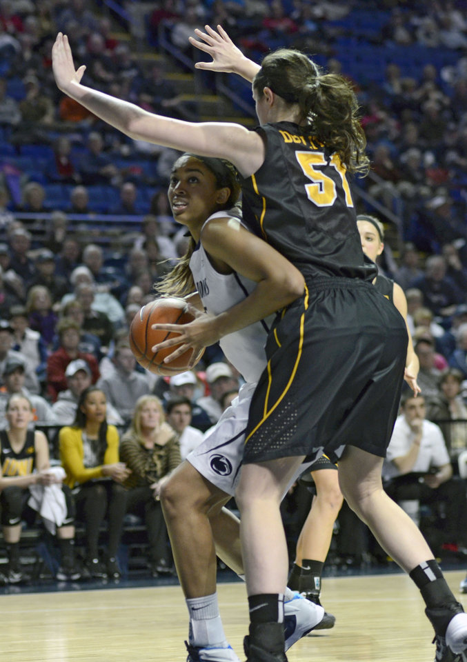 Photo - Penn State's Peyton Whitted (25) works around Iowa's Bethany Doolittle (51) during the first half of an NCAA college basketball game on Thursday, Feb. 6, 2014 in State College, Pa. (AP Photo/Ralph Wilson)