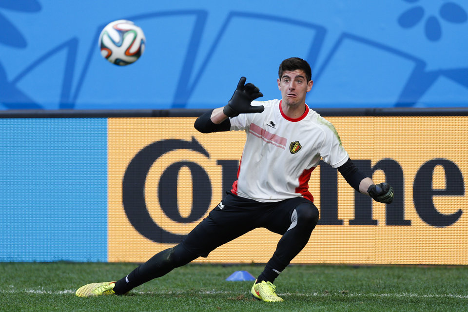 Photo - Belgium's goalkeeper Thibaut Courtois takes part in a practice session at Estadio Nacional in Brasilia, Brazil, Friday, July 4, 2014. On Saturday, Belgium will face Argentina in their World Cup quarterfinals soccer match. (AP Photo/Victor R. Caivano)