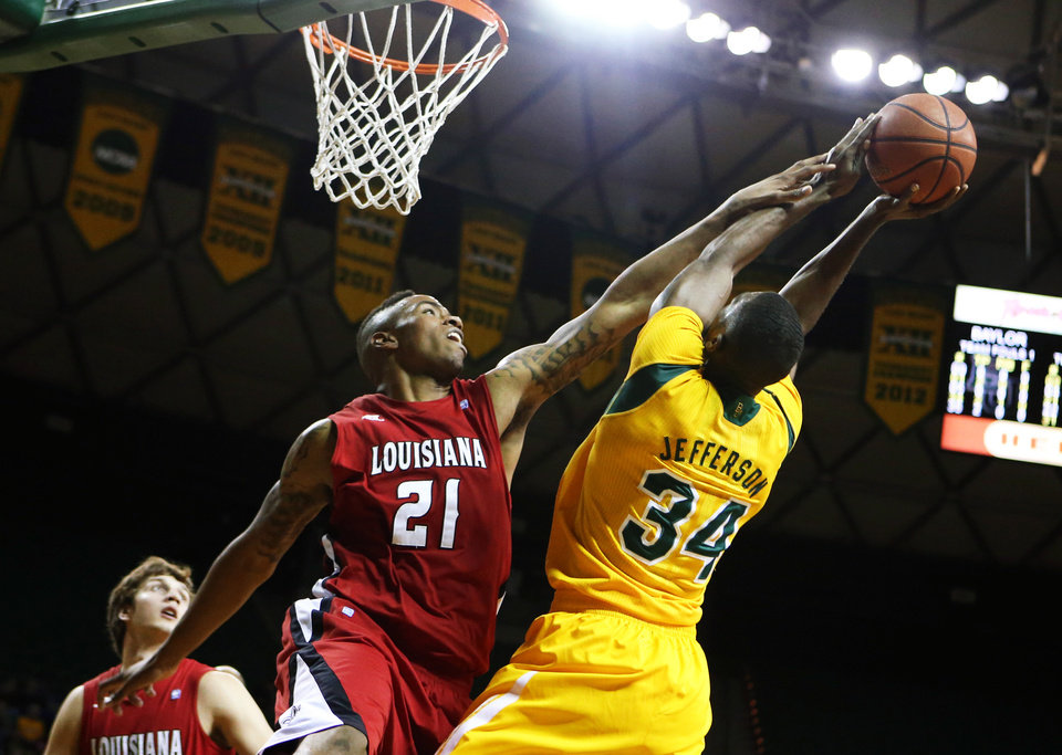 Louisiana Lafayette forward Shawn Long (21), left, pressures Baylor forward Cory Jefferson (34), right, in the first half of an NCAA college basketball game, Sunday, Nov. 17, 2013, in Waco, Texas. (AP Photo/Waco Tribune Herald, Rod Aydelotte)