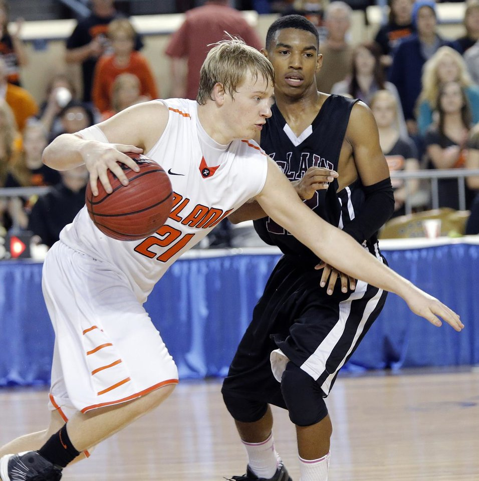 Roland's Brooks Robertson (21) drive past McLain's Bishop Louie (12) during the state high school basketball tournament Class 4A boys semifinal game between McLain High School and Roland High School at the State Fair Arena on Friday, March 8, 2013, in Oklahoma City, Okla. Photo by Chris Landsberger, The Oklahoman
