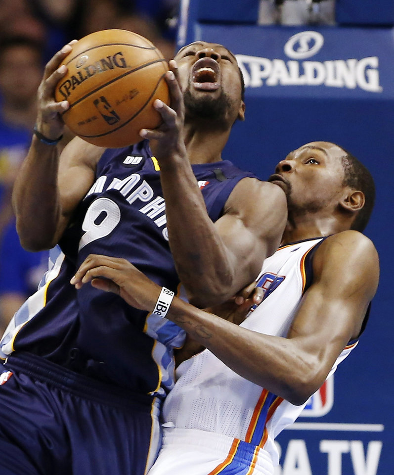 Photo - Memphis Grizzlies' Tony Allen, front, eyes the basket as Oklahoma City Thunder's Kevin Durant, rear, defends during the first half of Game 2 of their Western Conference Semifinals NBA basketball playoff series in Oklahoma City, Tuesday, May 7, 2013. (AP Photo/Alonzo Adams)