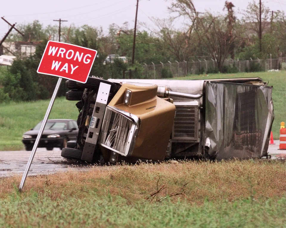 MAY 3, 1999 TORNADO: Tornado damage: An overturned truck rests on its side on the westbound lane of the Turner Turnpike near Stroud.