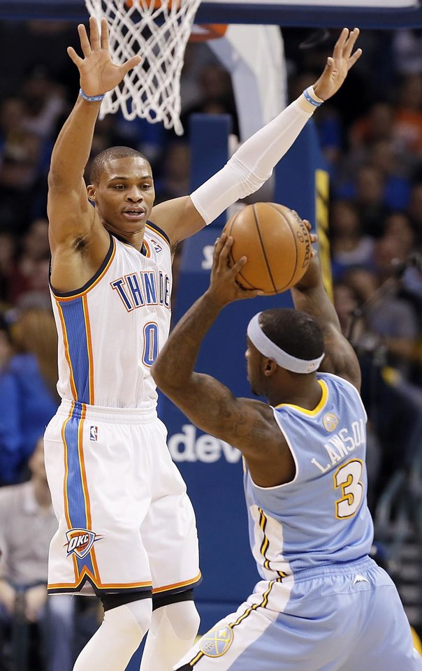 Photo - Oklahoma City's Russell Westbrook (0) defends on Denver's Ty Lawson (3) during the NBA basketball game between the Oklahoma City Thunder and the Denver Nuggets at the Chesapeake Energy Arena on Wednesday, Jan. 16, 2013, in Oklahoma City, Okla.  Photo by Chris Landsberger, The Oklahoman