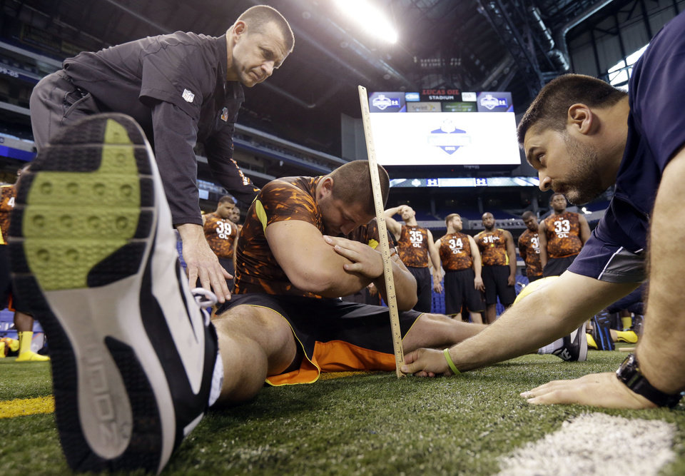 Photo - Cornell offensive lineman J C Tretter gets measured during the NFL football scouting combine in Indianapolis, Ind., Saturday, Feb. 23, 2013. (AP Photo/Dave Martin)