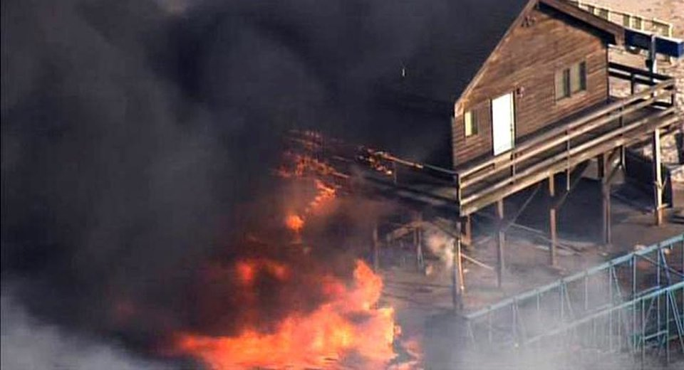 Photo - CORRECTS LOCATION TO SEASIDE HEIGHTS INSTEAD OF SEASIDE PARK - In this image taken from video and provided by Fox 29, flames engulf a building on the boardwalk in the resort community of Seaside Heights, N.J., Thursday, Sept. 12, 2013. The massive fire burned several blocks of boardwalk and businesses along the popular stretch of boardwalk, which was damaged by Superstorm Sandy and was being repaired. (AP Photo/Fox 29) NO SALES
