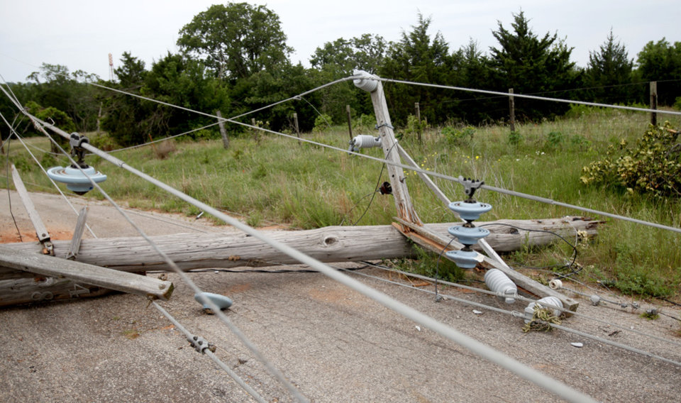Photo - TORNADO / STORM / DAMAGE / AFTERMATH / RECOVERY: A power line lays across a road near the Lake Stanley Draper  water treatment plant, Wednesday, May, 12, 2010, in Oklahoma City. Photo by Sarah Phipps, The Oklahoman  ORG XMIT: KOD