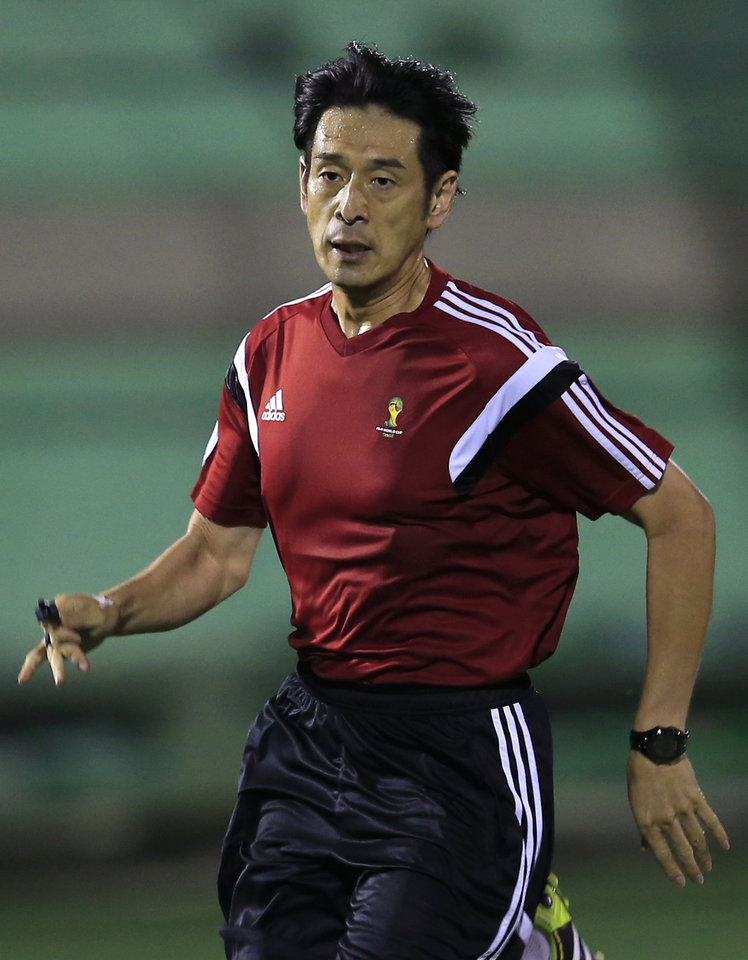 Photo - Referee Yuichi Nishimura from Japan runs during a referee's training session in Rio de Janeiro, Brazil, Friday, June 6, 2014. Brazil is hosting the World Cup soccer tournament that starts June 12. (AP Photo/Hassan Ammar)