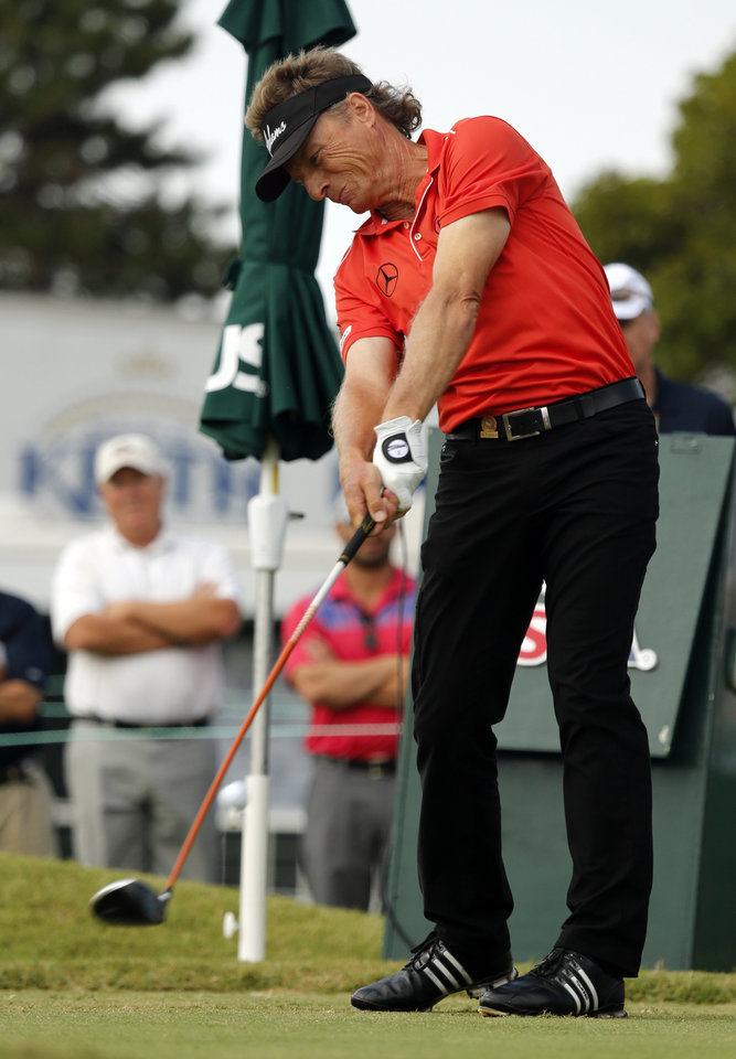 Photo - Bernhard Langer tees off on hole 10 during the first round of the U.S. Senior Open Championship golf tournament at Oak Tree National in Edmond, Okla. on Thursday, July 10, 2014. Photo by Steve Sisney, The Oklahoman
