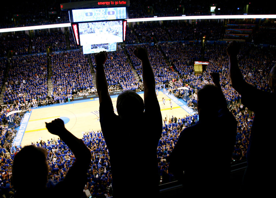 Photo - Oklahoma City Thunder fans cheer as the Thunder score the first points of the game during the first round NBA Playoff basketball game between the Thunder and the Denver Nuggets at OKC Arena in downtown Oklahoma City on Wednesday, April 20, 2011. Photo by John Clanton, The Oklahoman