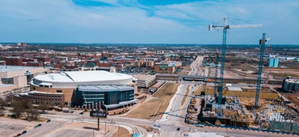 Photo -  The proposed location of Thunder Alley, between the Chesapeake Arena and the Oklahoma City Boulevard, is shown in this photo. The 17-story Omni Hotel can be seen rising up across the street. [DAVE MORRIS/THE OKLAHOMAN]