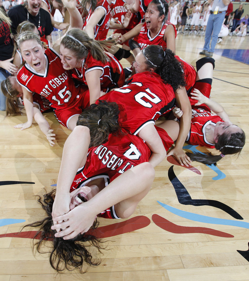 Fort Gibson's Nana Wallace, front, celebrates with her teammates after the 52-51 overtime win over Cache during the championship game of the 4A girls state championship tournament at the Big House in the State Fair Park on Saturday, March 12, 2011, in Oklahoma City, Okla.   Photo by Chris Landsberger, The Oklahoman