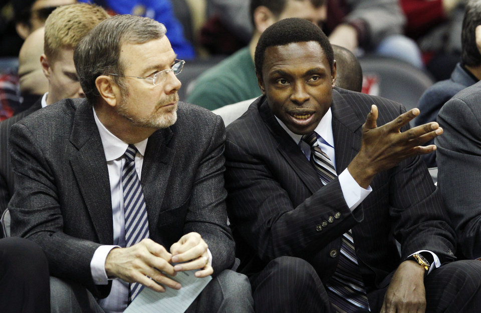FILE- In this Dec. 17, 2011, file photo, New Jersey Nets head coach Avery Johnson, right, talks with assistant coach P.J. Carlesimo during the first half of an NBA preseason basketball game against the New York Knicks in Newark, N.J. The Nets fired Johnson on Thursday, Dec. 27, 2012, and Carlesimo will coach the team on an interim basis, starting Friday night with a home game against Charlotte. (AP Photo/Mel Evans, File)