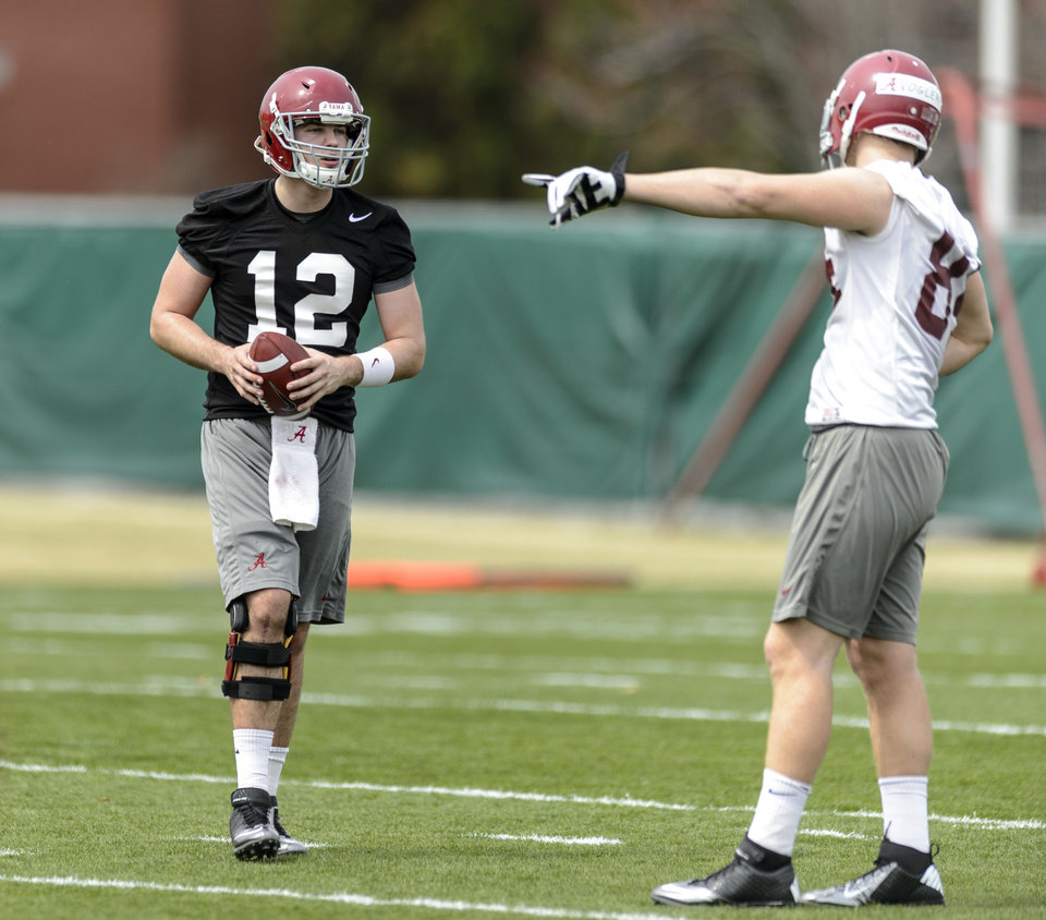 Photo - Alabama quarterback David Cornwell (12) works with the tight ends during spring NCAA college football practice, Saturday, March 15, 2014, at the Thomas-Drew Practice Facility in Tuscaloosa, Ala. (AP Photo/Alabama Media Group, Vasha Hunt) MAGS OUT