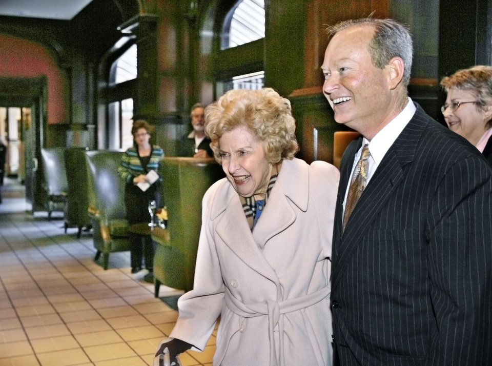 Photo -  Oklahoma City Mayor Mick Cornett escorts Betty Ellis, grandaughter of W.B. Skirvin, into the hotel's lobby, as the pair are the first to enter the hotel at the end of ceremonies in 2007 for the long-awaited re-opening of the Skirvin Hilton.  Oklahoman Archives Photo   DAVID MCDANIEL -  THE OKLAHOMAN