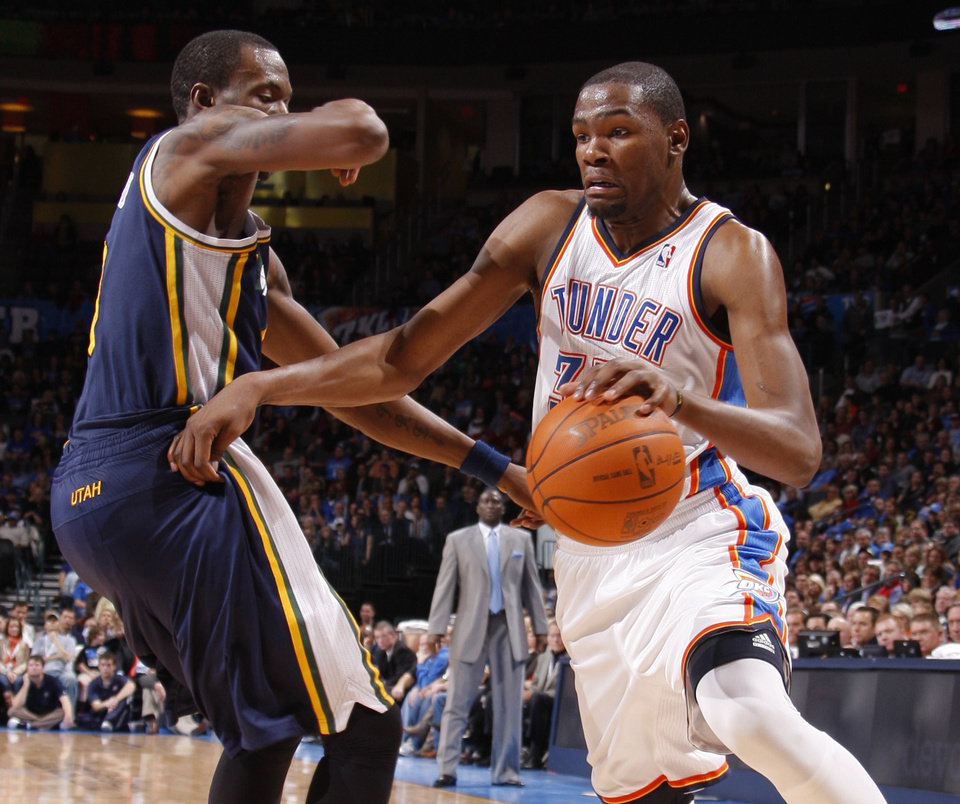 Oklahoma City's Kevin Durant (35) tries to get around Utah's Josh Howard (8) during an NBA game between the Oklahoma City Thunder and the Utah Jazz at Chesapeake Energy Arena in Oklahoma CIty, Tuesday, Feb. 14, 2012. Photo by Bryan Terry, The Oklahoman