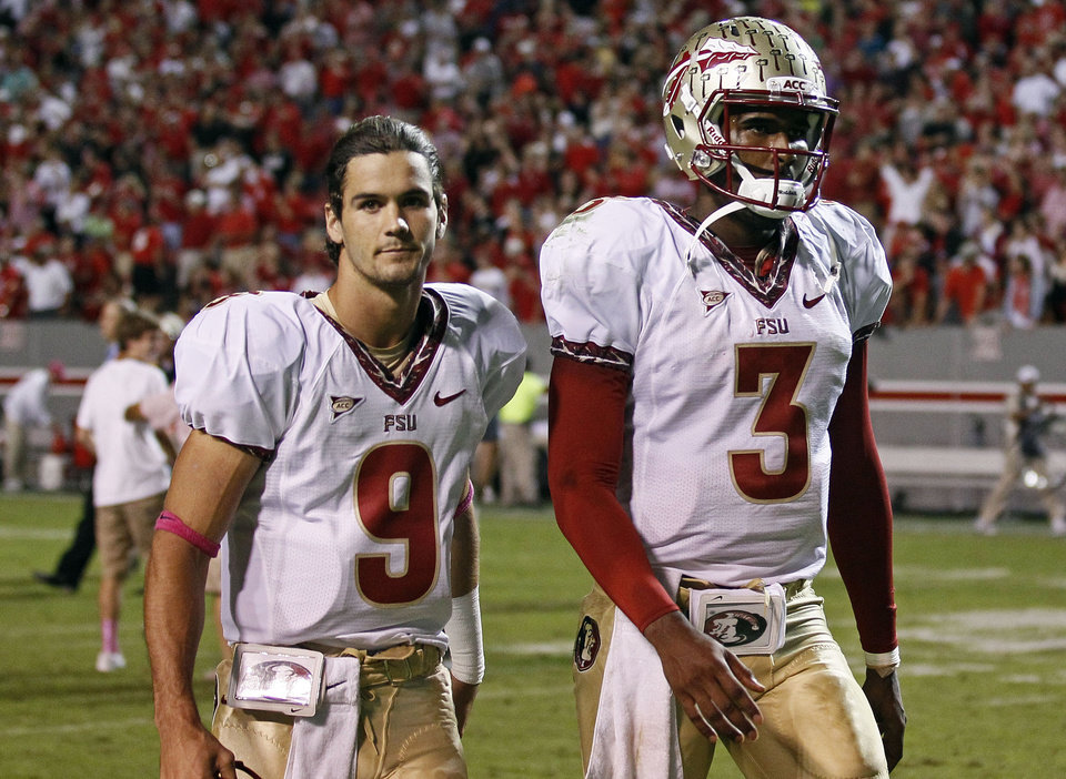 Photo -   Florida State's Clint Trickett (9) and quarterback EJ Manuel (3) leave the field following Florida State's 17-16 loss to North Carolina State in an NCAA college football game in Raleigh, N.C., Saturday, Oct. 6, 2012. (AP Photo/Gerry Broome)