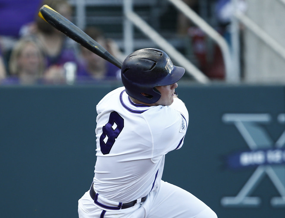 Photo - TCU's Boomer White follows through for a double against Siena during the first inning of an NCAA college baseball regional tournament game in Fort Worth, Texas, Friday, May 30, 2014. (AP Photo/Jim Cowsert)