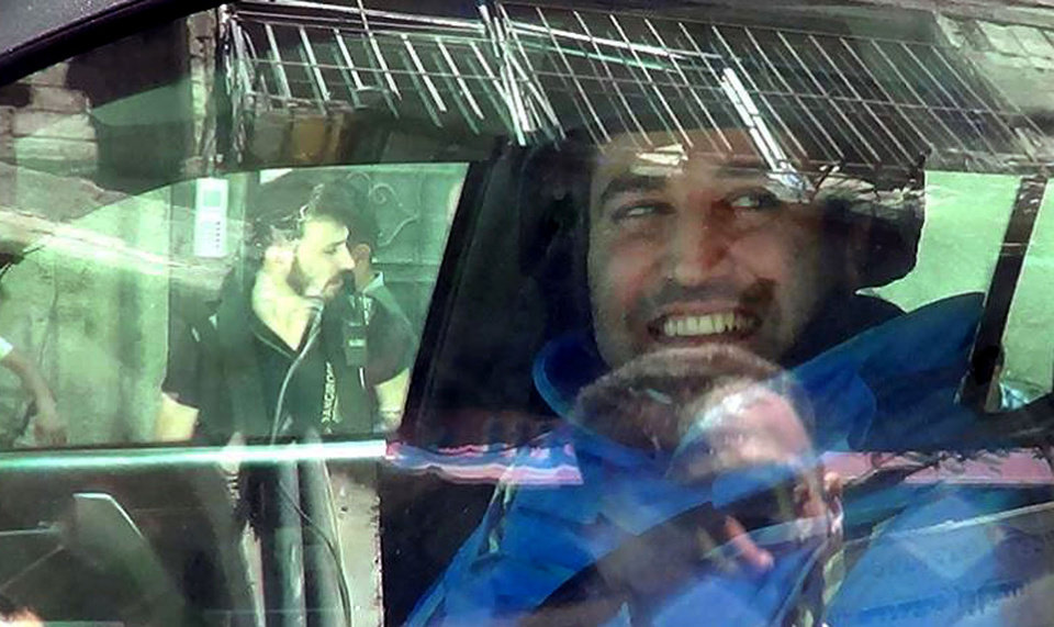 Photo - In this citizen journalism image provided by the United media office of Arbeen which has been authenticated based on its contents and other AP reporting, a member of UN investigation team, smiles as he sits inside his vehicle, in Damascus countryside of Zamalka, Syria, Wednesday, Aug. 28, 2013. U.N. chemical weapons experts headed to a Damascus suburb on Wednesday for a new tour of areas struck by a purported poison gas attack, activists said, as Western powers laid the groundwork for a possible punitive strike and the U.N. chief pleaded for more time for diplomacy. (AP Photo/United media office of Arbeen)