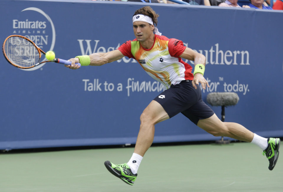 Photo - David Ferrer, from Spain, hits a forehand against Roger Federer, from Switzerland, during a final match at the Western & Southern Open tennis tournament, Sunday, Aug. 17, 2014, in Mason, Ohio. (AP Photo/Al Behrman)