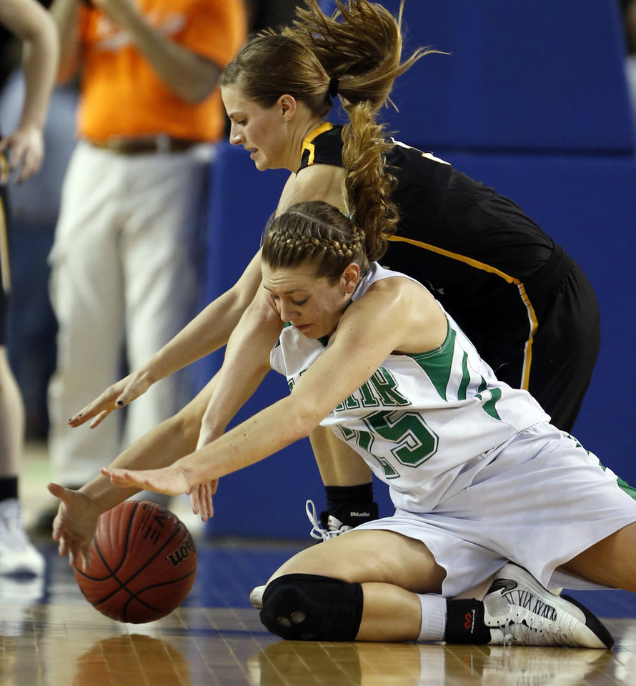 Photo - Alva's Bailey Forell, back, tries to tie up Molly Kerr as the Adair Lady Warriors play the Alva Lady Goldbugs in the finals of the State Class 3A Girls Basketball Tournament at the Fairgrounds Arena on Saturday, March 15, 2014, in Oklahoma City, Okla. Photo by Steve Sisney, The Oklahoman
